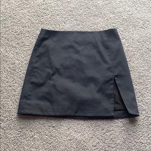 Black mini skirt with slit